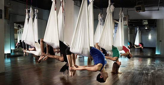 7 Ways Aerial Yoga Will Take Your Workout to the Next Level