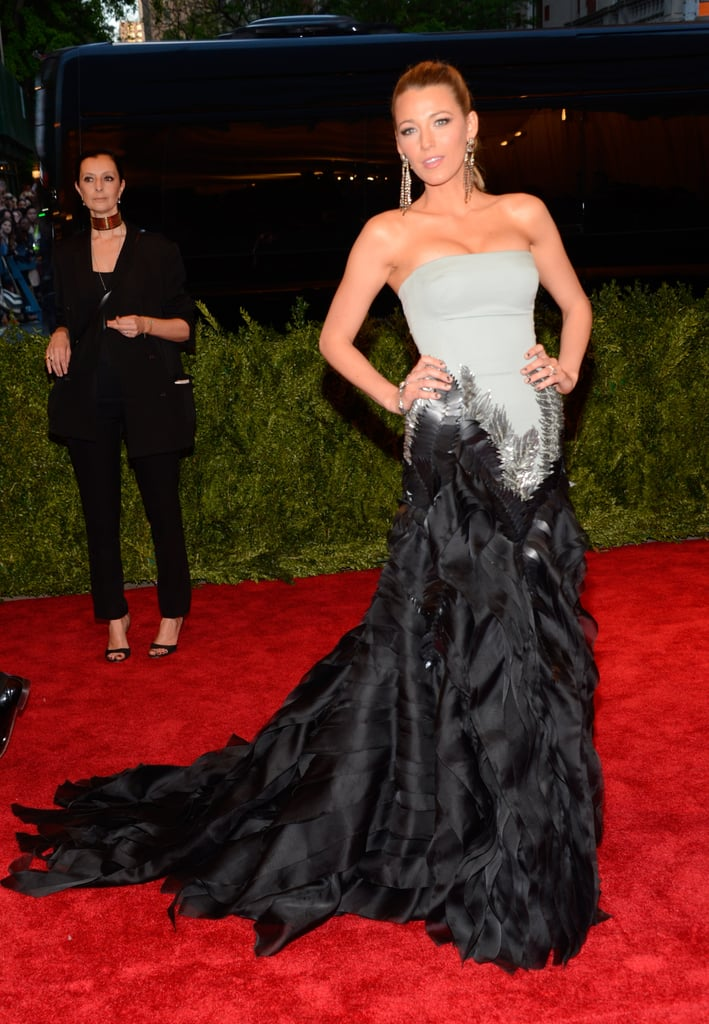 Blake Lively was every bit the movie star in her Gucci Première pale green strapless gown with silver and matte black feather embroideries. She finished off the look with Lorraine Schwartz jewels.