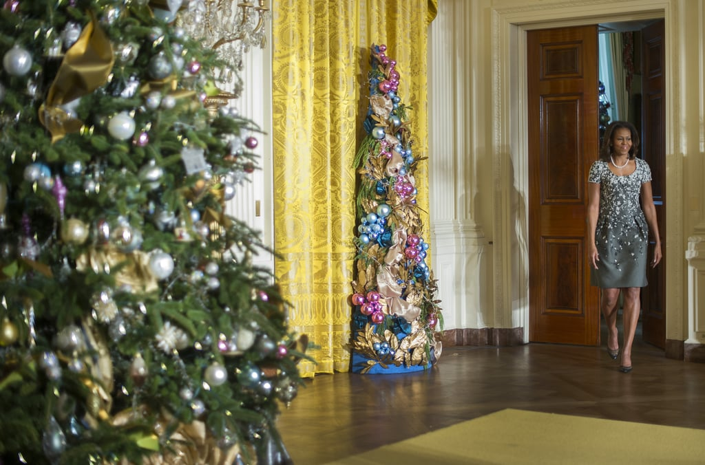 Michelle Obama chose a floral-print Carolina Herrera dress to unveil the 2013 White House Christmas decorations.