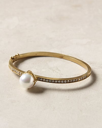 This has an antique quality — one that looks like it was passed down for generations.  Savoy Pearl Bangle ($198)