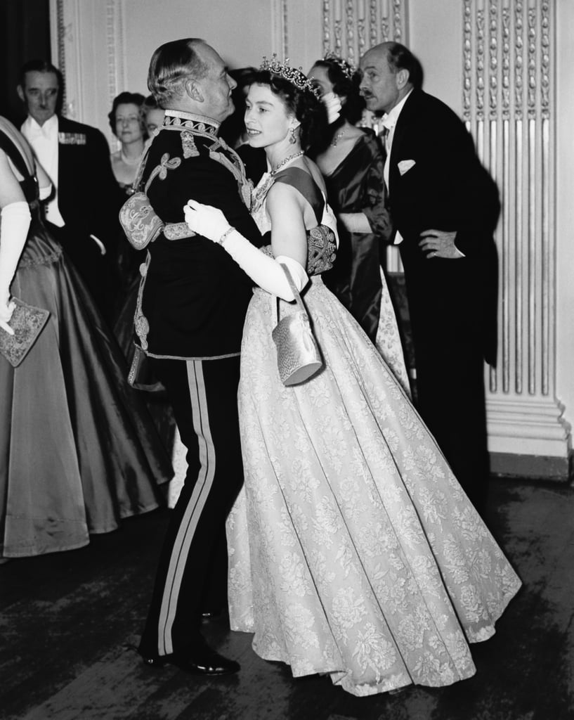 Dancing with Air Marshal Sir John Baldwin at a ball held at Hyde Park Hotel in London in Nov. 1954.