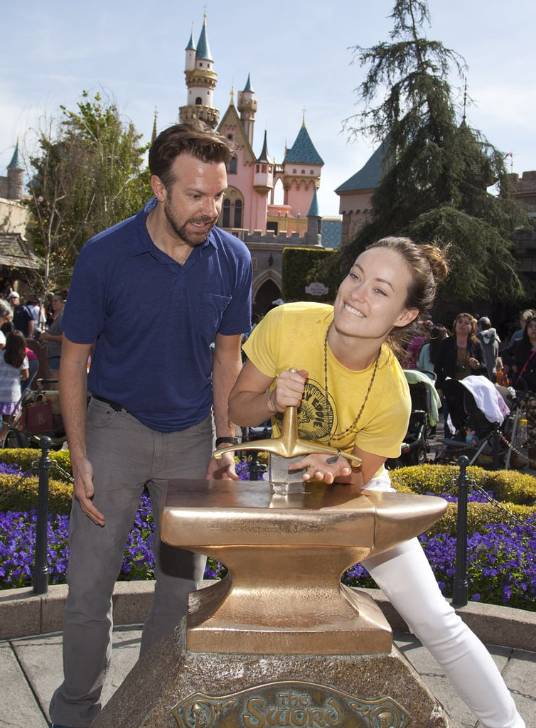 Olivia Wilde and Jason Sudeikis had a funny moment while trying their luck at removing the famous Sword in the Stone at Disneyland in March 2013.