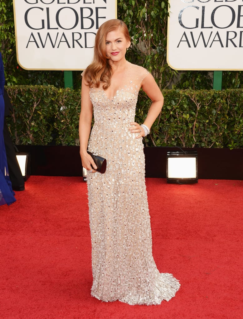 Mom of two Isla Fisher — Olive, 5, and Elula, 2 — sparkled in a nude-hued beaded gown by Reem Acra.