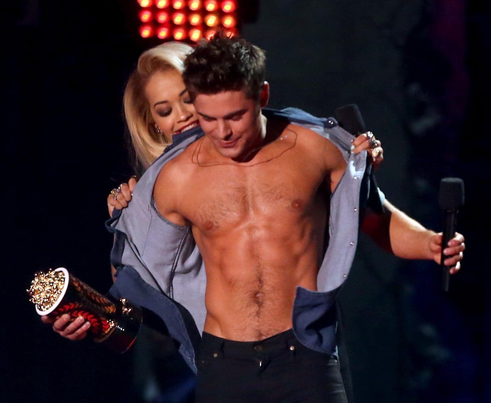 Do not envy Rita Ora's proximity to his abs.