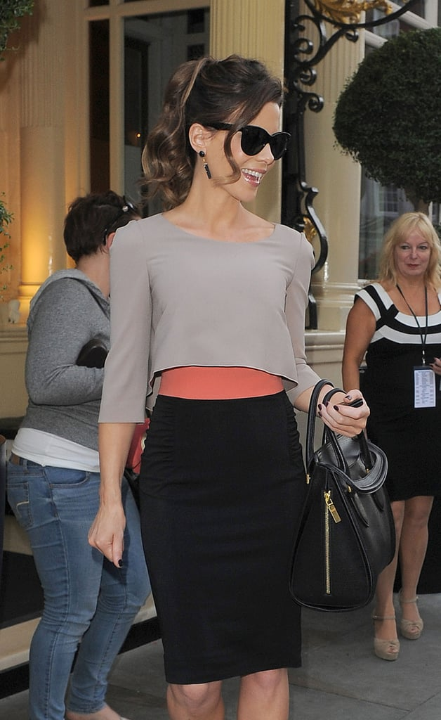 Kate Beckinsale posed on her way into a private screening of Total Recall in London.