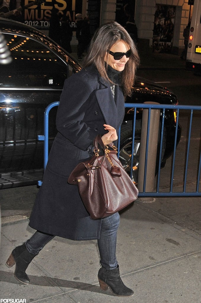 Katie Holmes wore sunglasses as she walked into the Music Box Theatre.