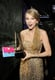 Taylor held on to her American Music Award while backstage at the event in November 2011.