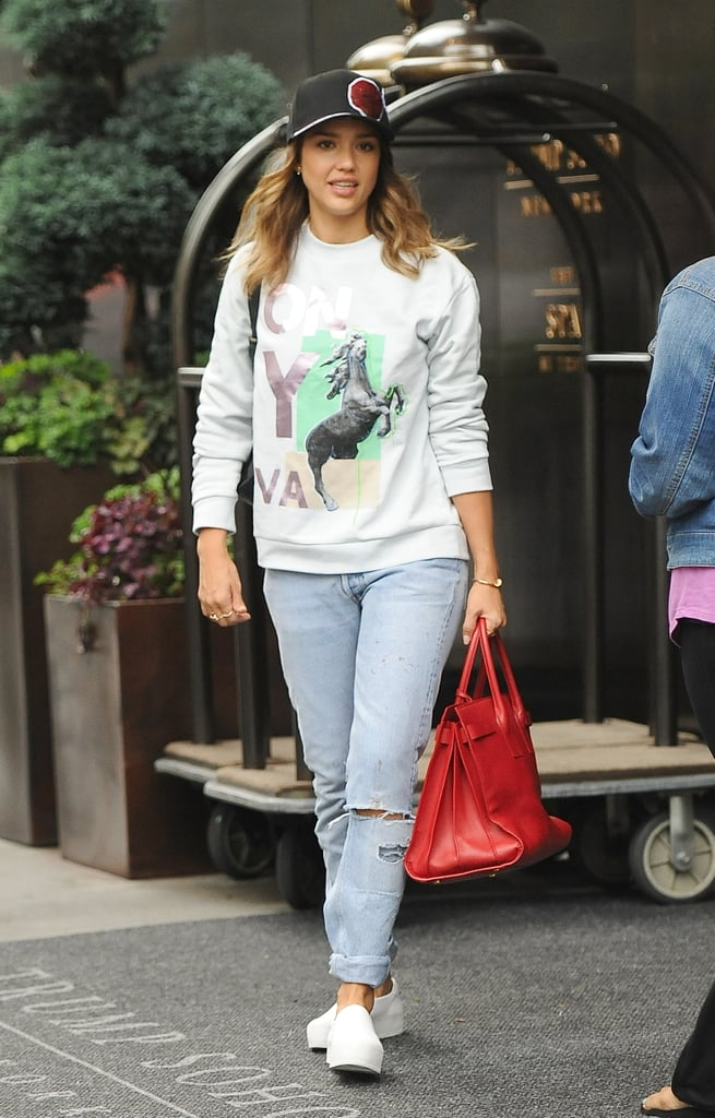 Jessica went cool and casual, adding a graphic crew-neck and cap to her loose denim bottoms.