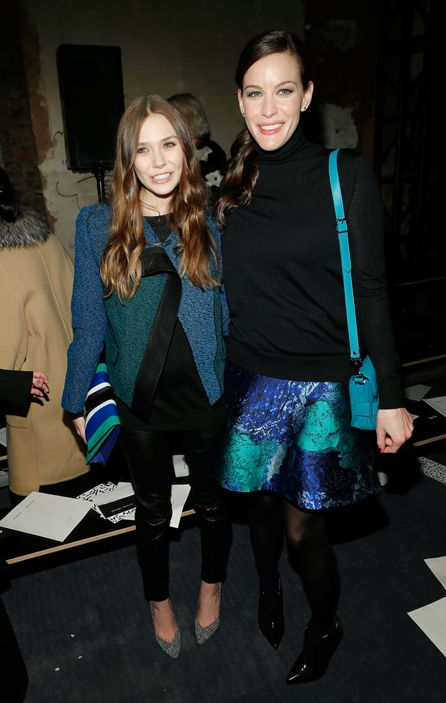 Elizabeth Olsen and Liv Tyler posed together at the Proenza Schouler presentation at New York Fashion Week in February.