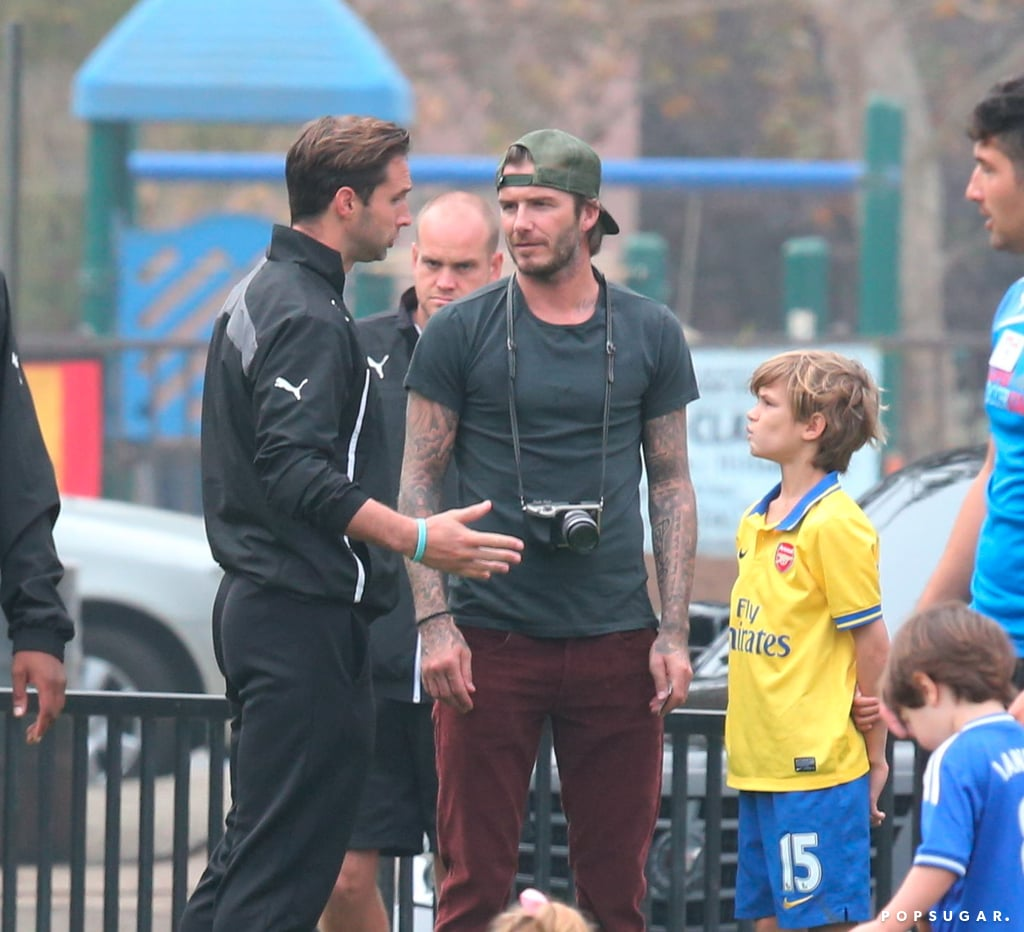 David Beckham snapped pictures of his little girl while she played soccer.