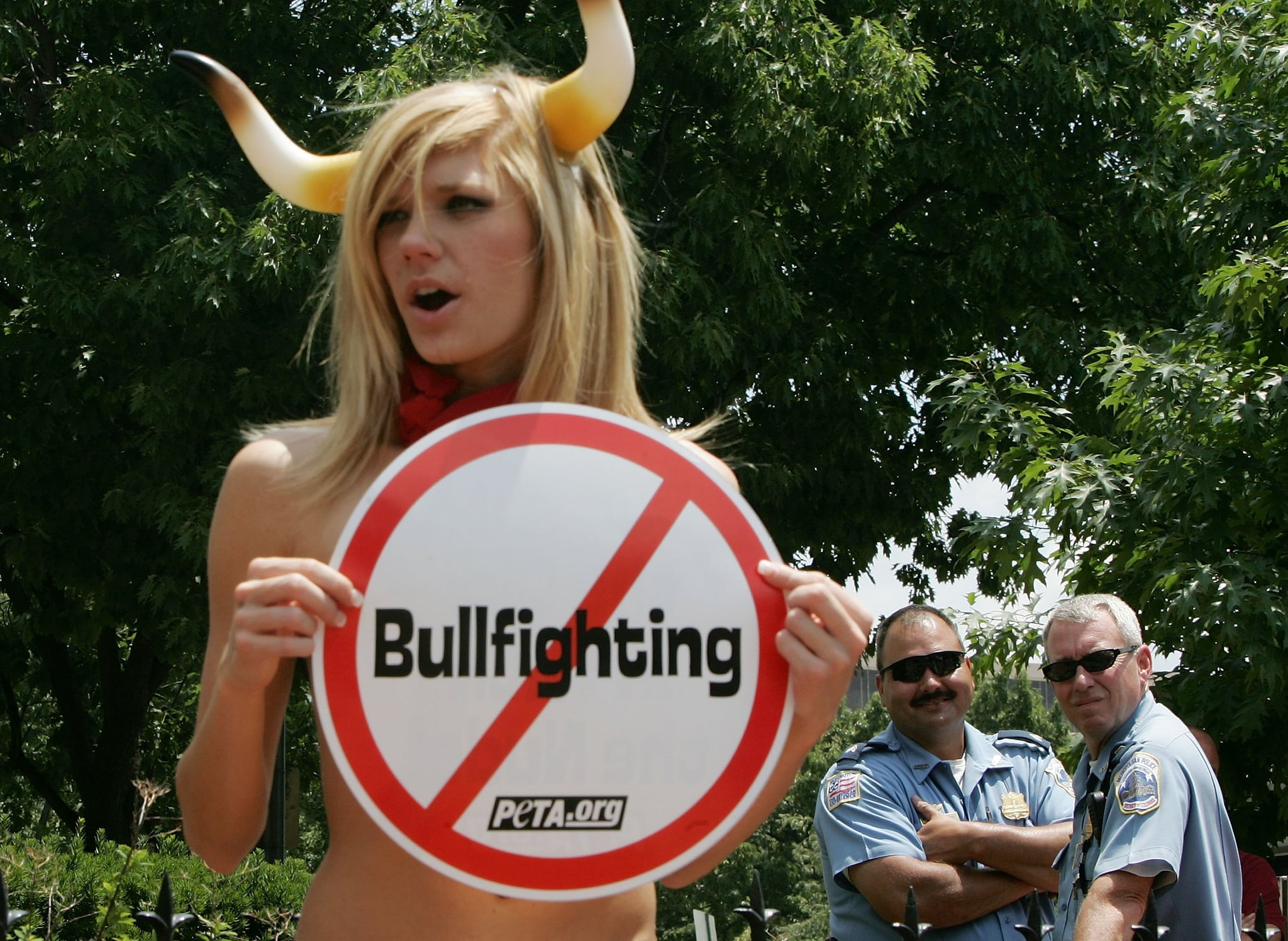 A protester opts for the Running of the Nude.