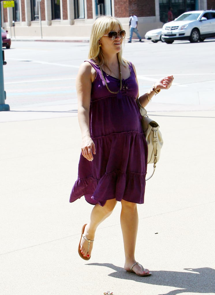 Pregnant Reese Witherspoon went to a meeting.