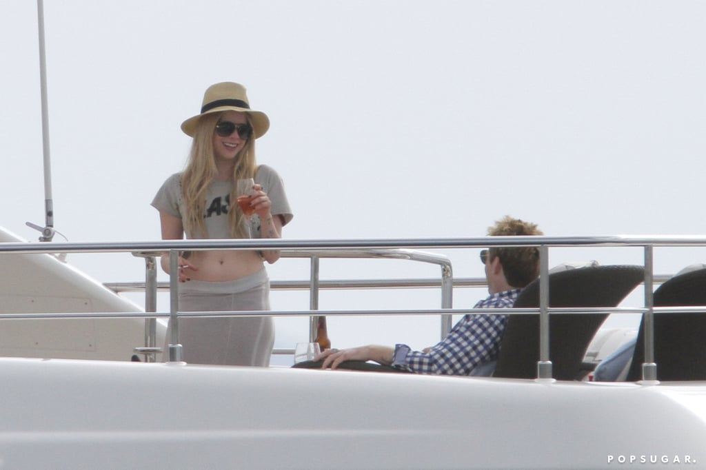 Avril Lavigne and her husband Chad Kroeger relaxed on a yacht before their wedding.