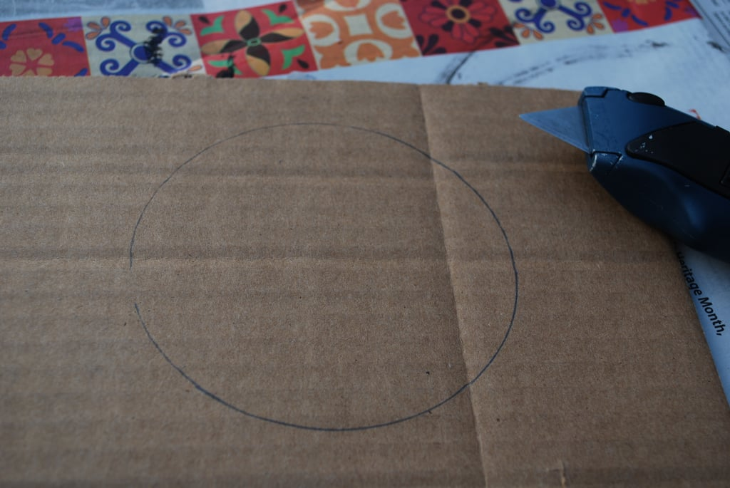 Using a spare piece of cardboard, cut a small circle (about six inches in diameter).