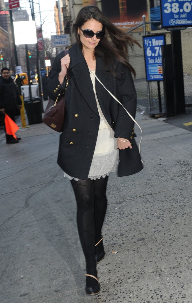 Katie Holmes wore a navy blue coat.