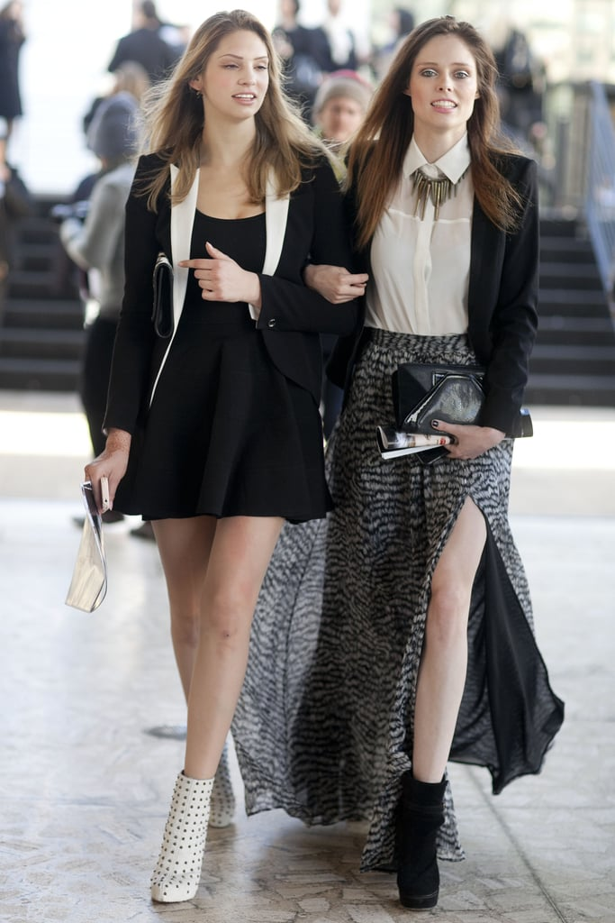 Coco Rocha coordinated with her show-going companion. Both opted for white and black, albeit with totally different vibes. Coco's is a more free-spirited play with the two-tone color story, while at left, we get a much more deliberate white and black contrast.