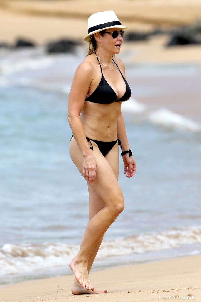 Chelsea Handler walked along the beach in Hawaii.