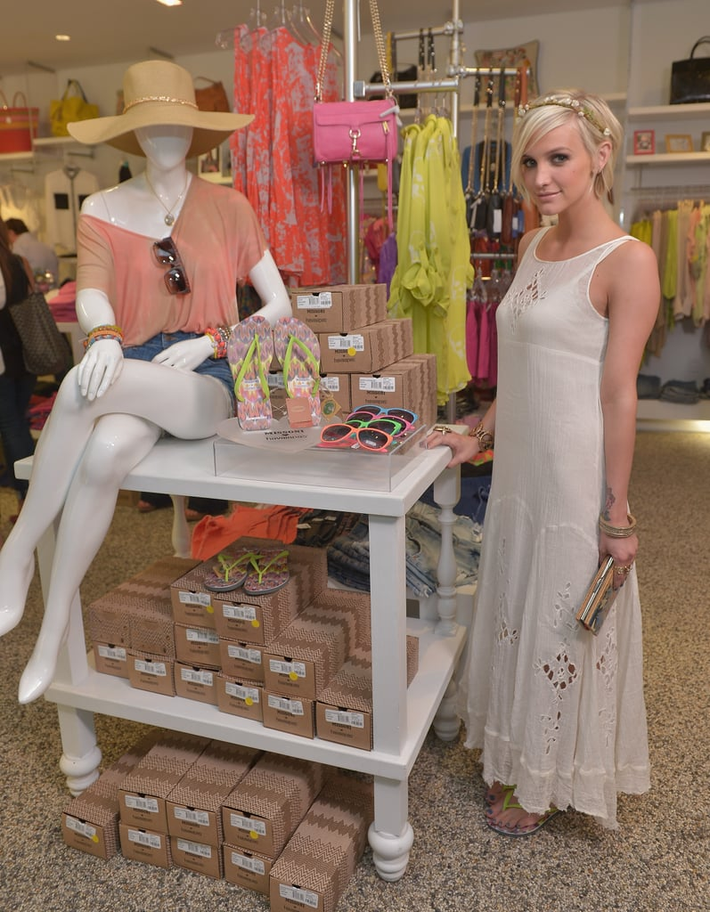 Ashlee Simpson posed inside Kitson next to a table of fun accessories.
