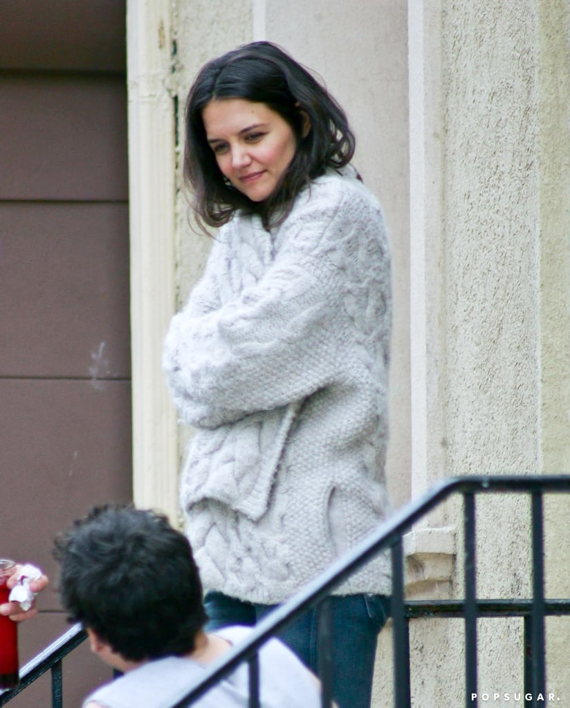 Katie Holmes threw on a sweater between takes for Mania Days in NYC.