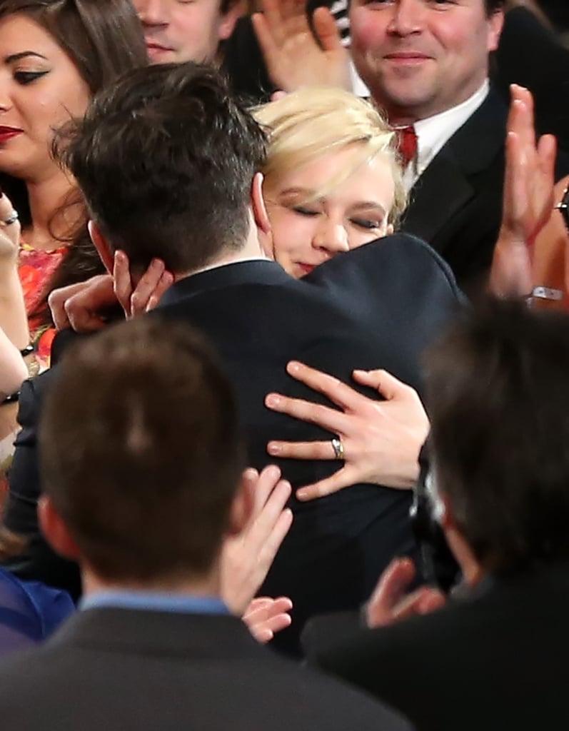 Carey Mulligan hugged her husband, Marcus Mumford, after his big win with Mumford & Sons.