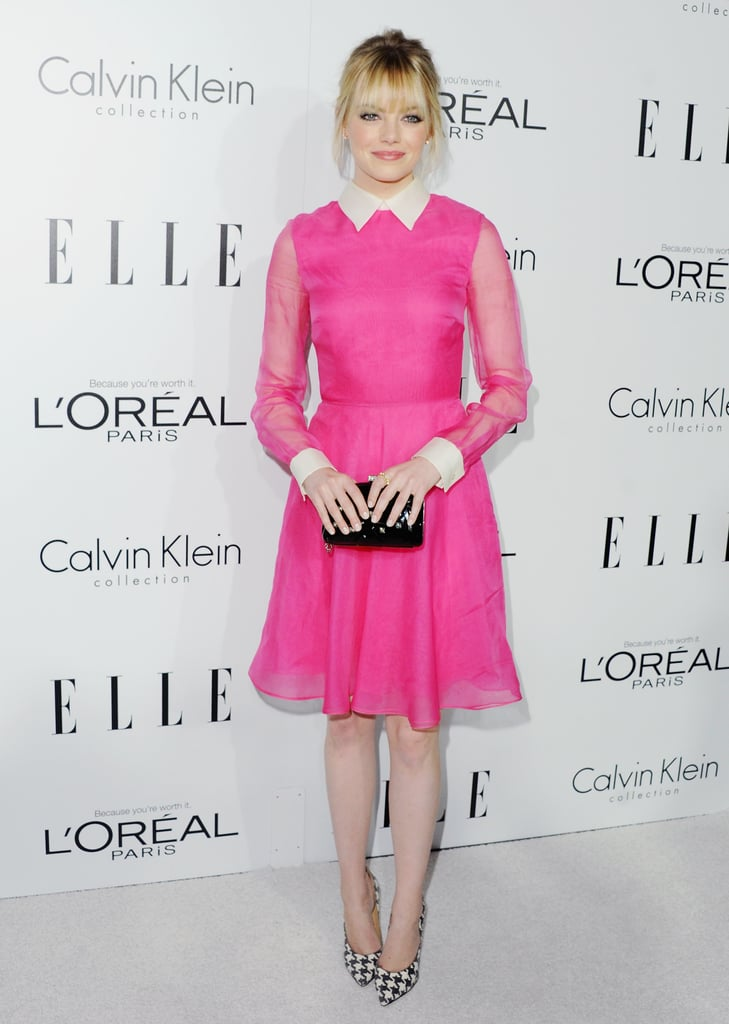 Emma Stone showed off a brilliant bright pink on a charming Valentino dress, then added flair with a pair of houndstooth-printed pumps.