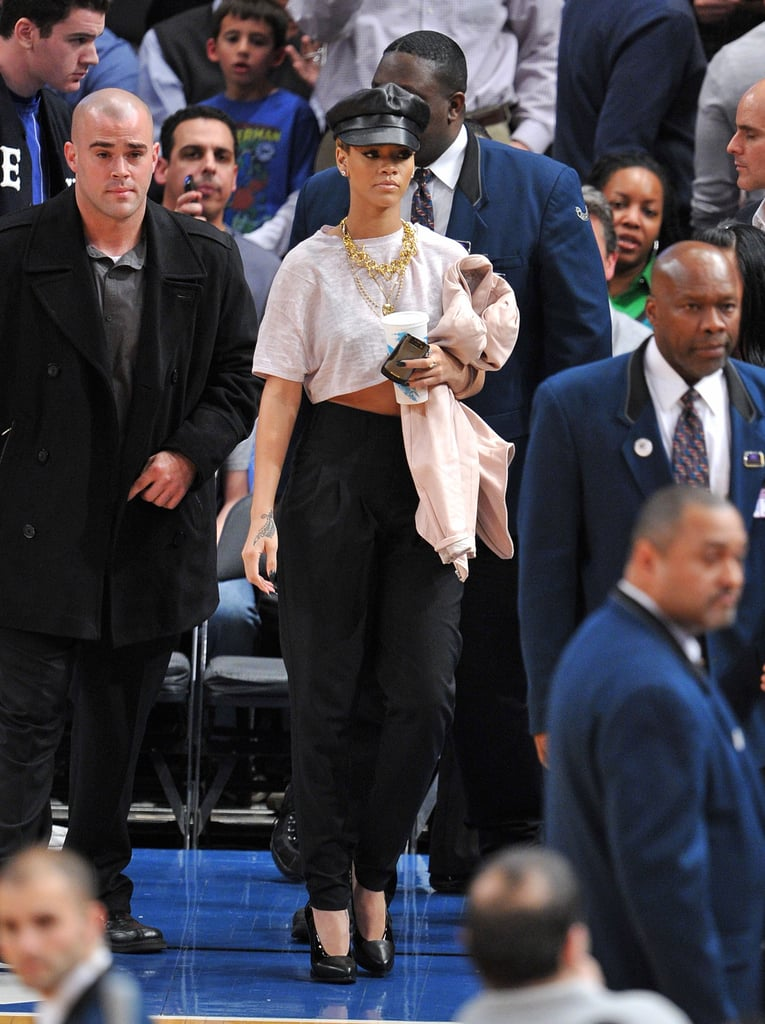 In 2009, the diva topped her NYC game-day style, a cropped white tee and high-waisted pleated pants, with a leather newsboy cap and glistening gold add-ons.