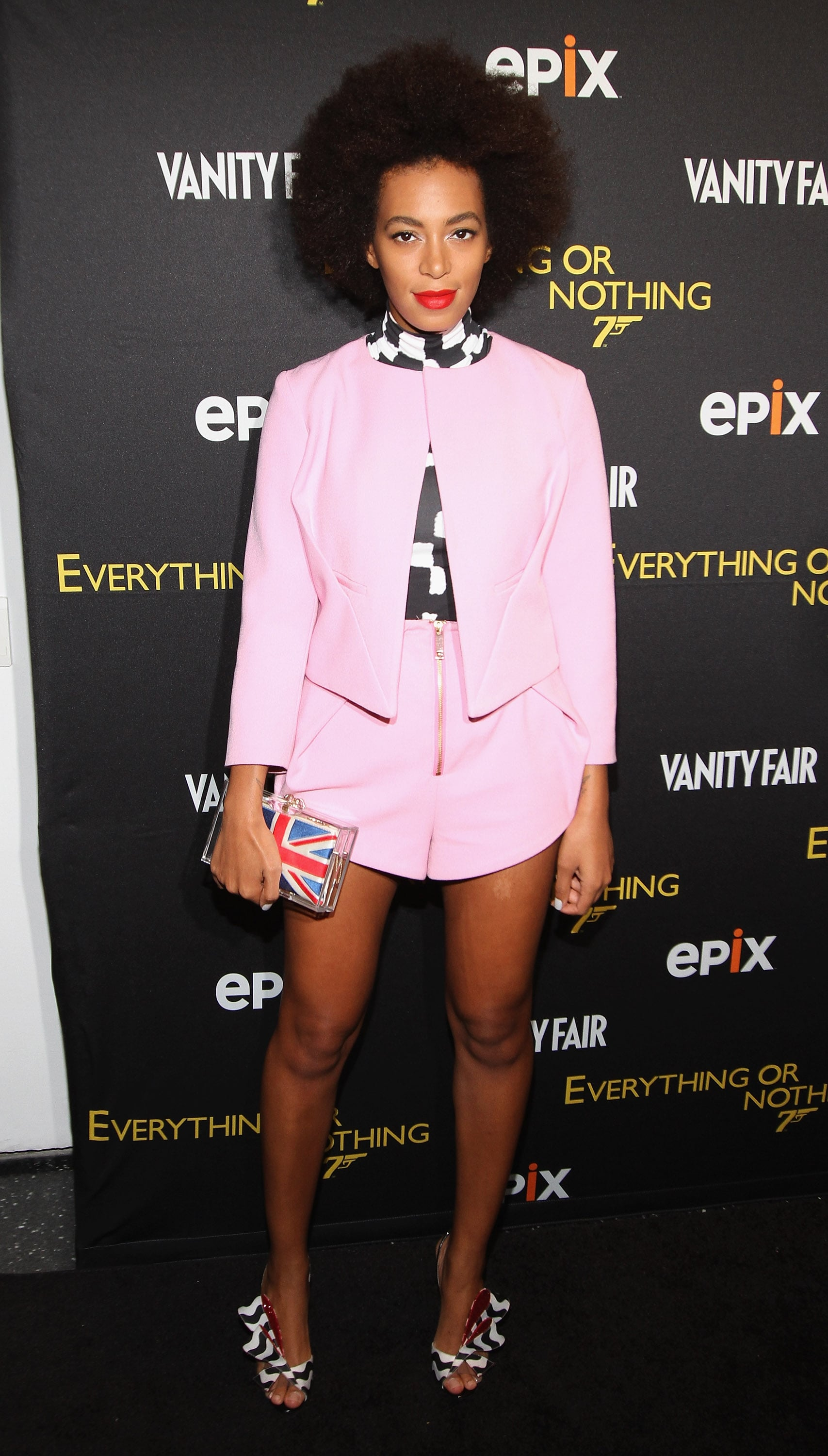 Solange Knowles dared to wear a pink Twenty8Twelve shorts suit with a checkered turtleneck and matching black-and-white printed Nicholas Kirkwood sandals at the NYC premiere of Everything or Nothing.