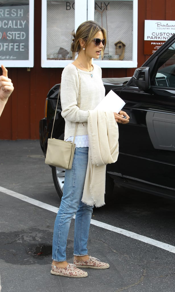 This is how we want to look every single Sunday. Alessandra Ambrosio looked ultra-cosy and cute in a loose cream jumper, roomy denim jeans and flat Soludos shoes.