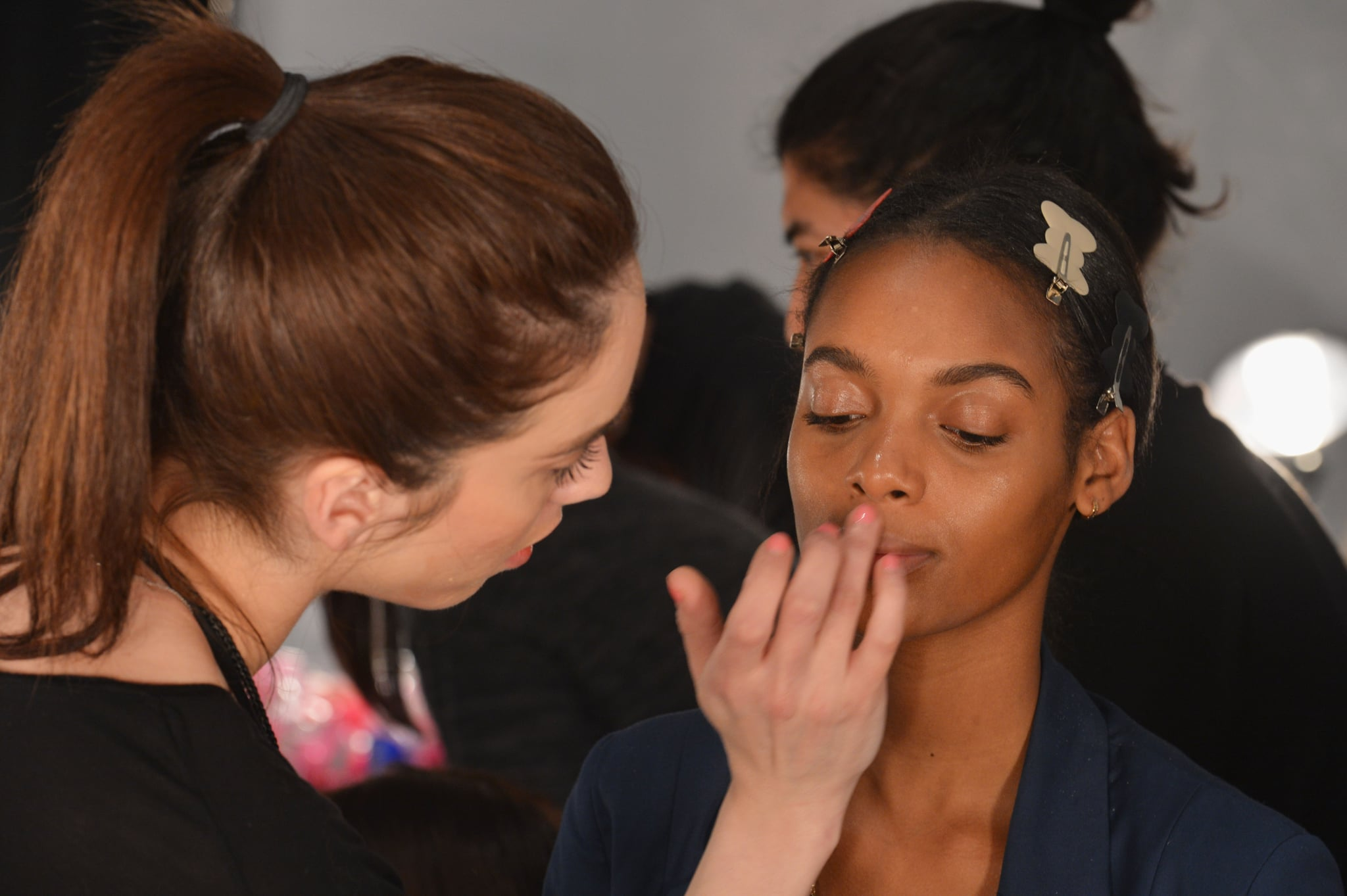 """""""It's pretty grunge,"""" lead makeup artist Romy Soleimani said. """"The collection had futuristic and sporty elements. We used the gloss on the cheeks and on the eyelid, so it's a little bit sweaty but also reflective."""" Her primary product was MAC Clear Lipglass and a bit of Haute and Naughty mascara. """""""