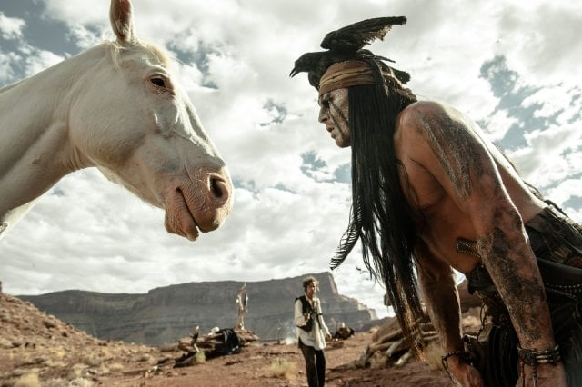 Johnny Depp has some distracting headware, but he's still shirtless in The Lone Ranger.