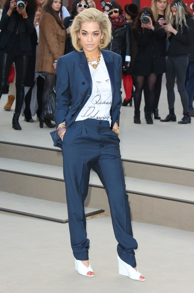 At Burberry Prorsum, Rita Ora's blue pant suit was completed with white peep-toe pumps and a Queen Delevingne (as in her friend Cara) tee.