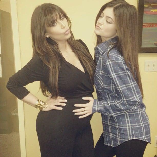 Kylie Jenner placed a hand on Kim Kardashian's baby bump. Source: Instagram user kimkardashian
