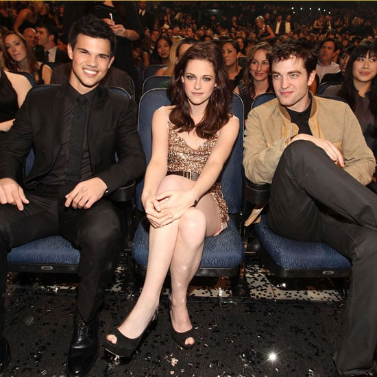 Kristen Stewart had a sweet spot between her leading men, Robert Pattinson and Taylor Lautner, at the January 2011 People's Choice Awards in LA.
