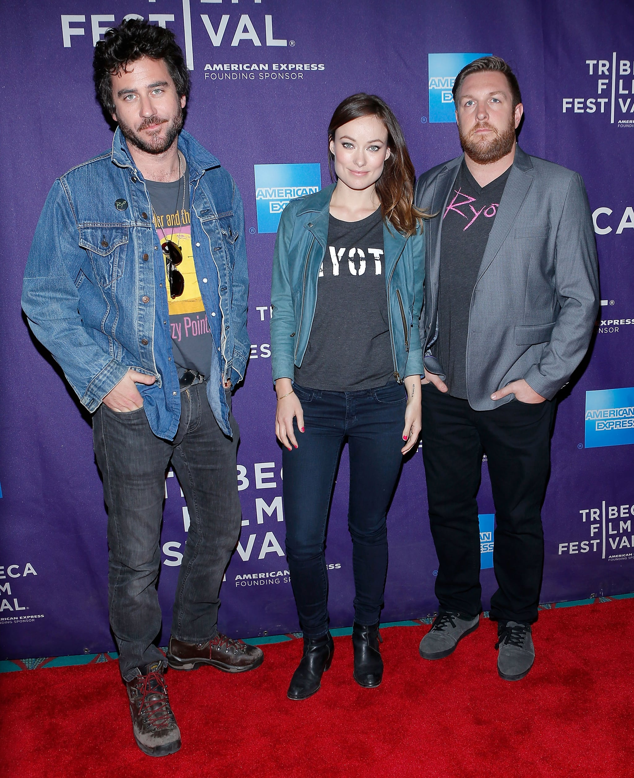 Olivia Wilde posed with Bryn Mooser and David Darg on the red carpet for a screening of The Rider and the Storm during the Tribeca Film Festival's shorts programs.