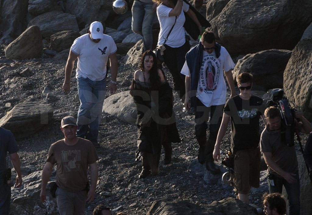 Kristen covered up between scenes.
