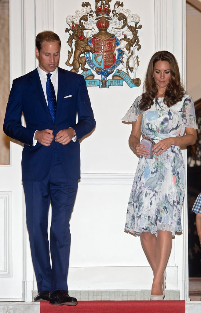 Prince William wore a blue suit while Kate Middleton donned an Erdem dress in Singapore.