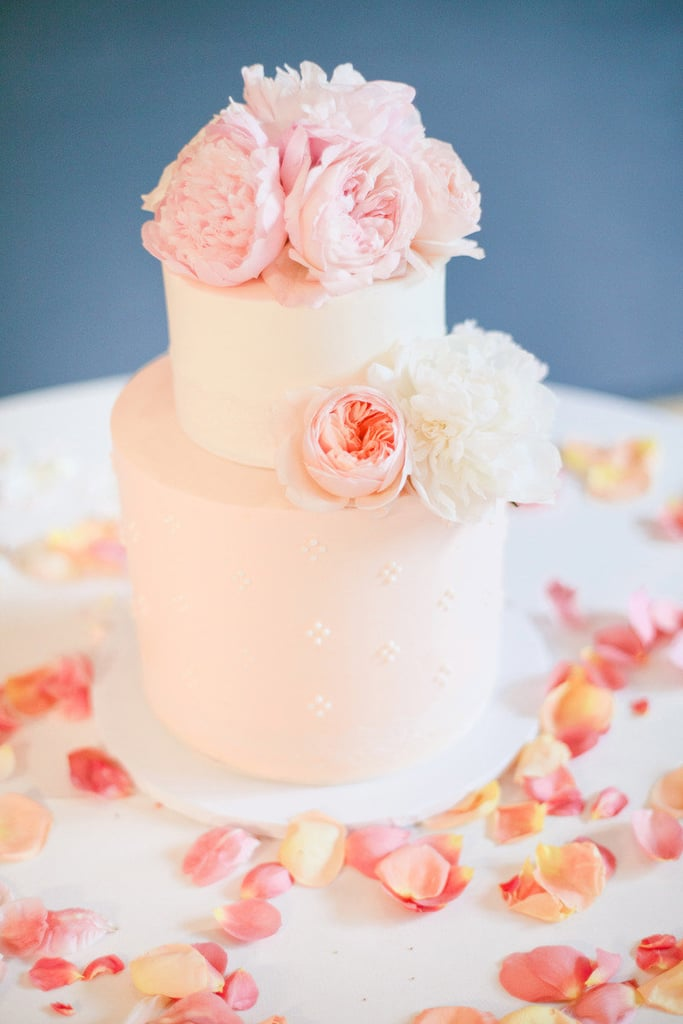 A soft eyelet pattern on the base layer of this cake and the two tones are the perfect amount of detail to make this a beautiful dessert without going over the top.  Photo by Connie Lyu Photography via Style Me Pretty