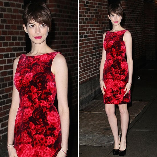 Anne Hathaway's red floral sheath is holiday-perfect.