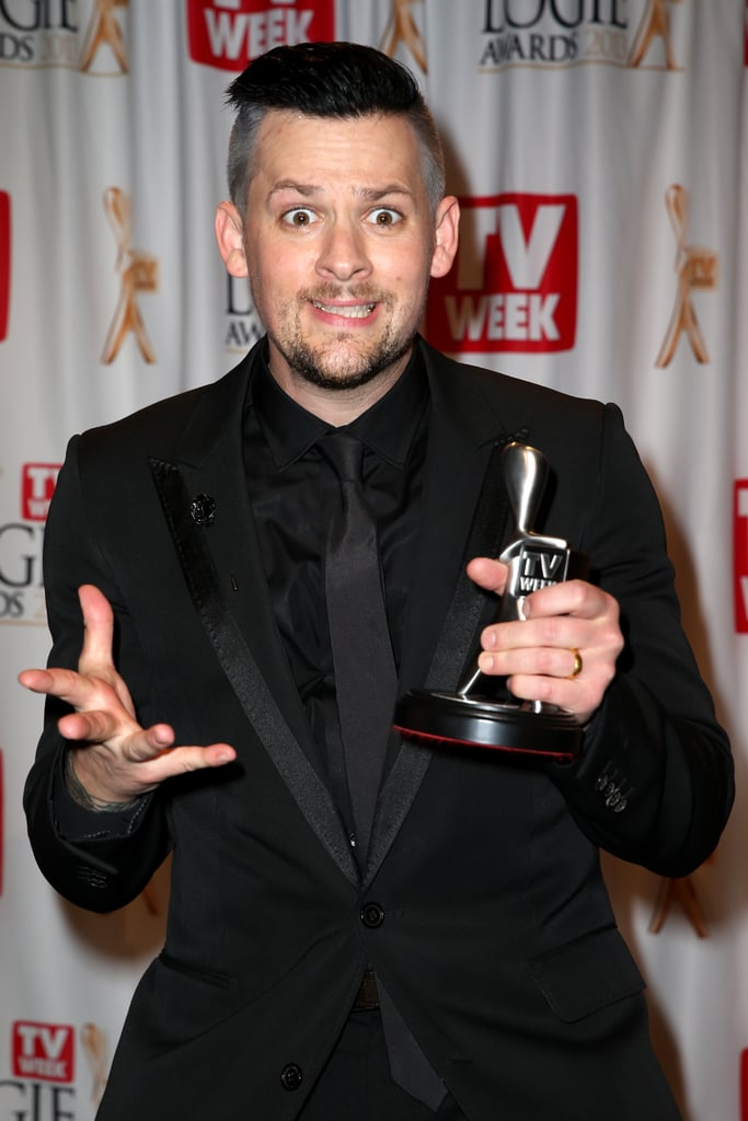 Joel Madden held his award for Most Popular New Male Talent — for his work on The Voice — at the Logie Awards on April 7.