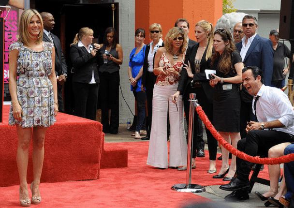 Justin was full of laughs during Jen's July 2011 Hand and Footprint ceremony in LA.