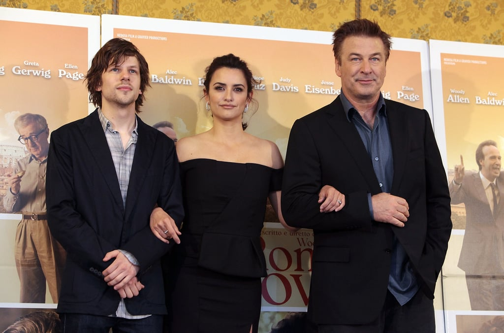 Alec Baldwin, Penelope Cruz and Jesse Eisenberg all linked arms as the posed for the press in Rome.