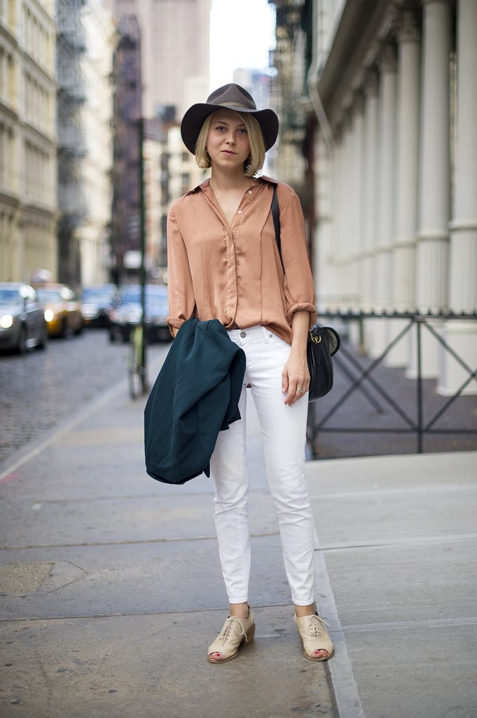 Don't fear the styling impact of a cool hat — this one lends a sweet tomboy feel to her basics.