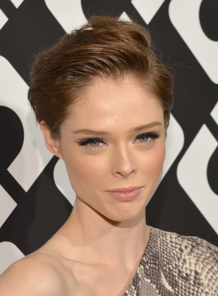 Coco Rocha proved that a pixie cut is incredibly versatile with this swept-up style, and her heavy eyeliner with just a touch of silver added a slightly sexy accent to her otherwise neutral makeup palette.