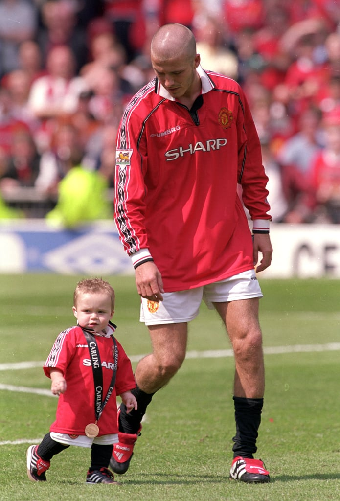 In May 2000, David Beckham gave young Brooklyn his medal after a celebration with Manchester United in Manchester, England.