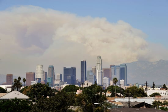 Front Page: Los Angeles Wildfires Double in Size
