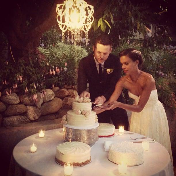 During their big day, Damien Fahey and Grasie Mercedes cut the cake underneath a chandelier.  Source: Instagram user bradleymeinz