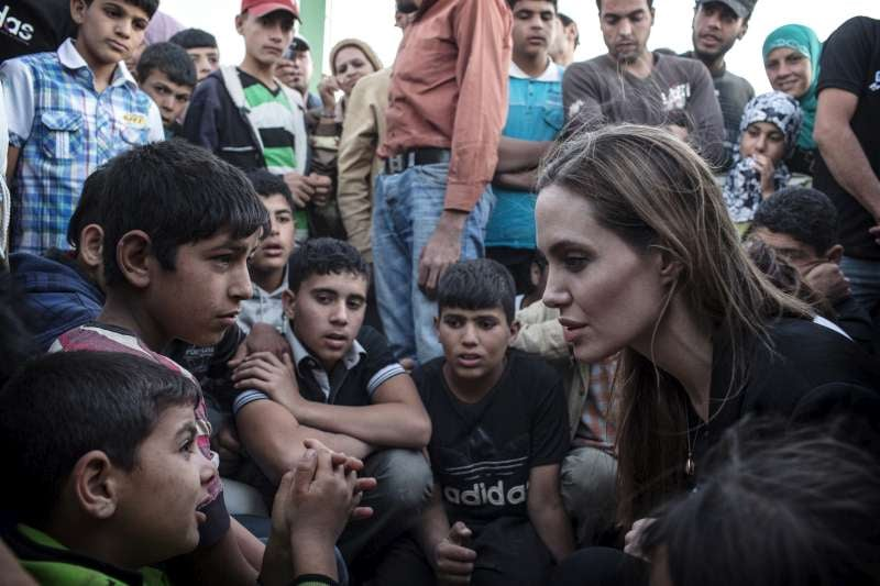 Angelina Jolie returned to her charity duties, speaking with Syrian refugees on the Jordanian border on June 19.