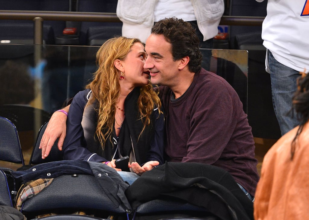 Mary-Kate Olsen gave boyfriend Olivier Sarkozy a kiss.