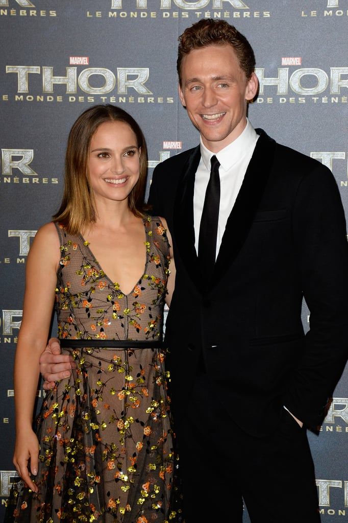 Natalie Portman and costar Tom Hiddleston smiled for the cameras at the Paris premiere of Thor: The Dark World on Wednesday.