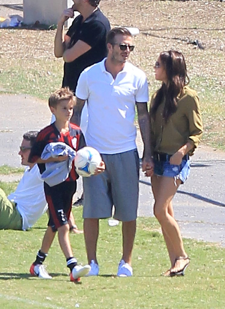 Victoria Beckham and David Beckham held hands while they supported son Cruz at his soccer game in LA.